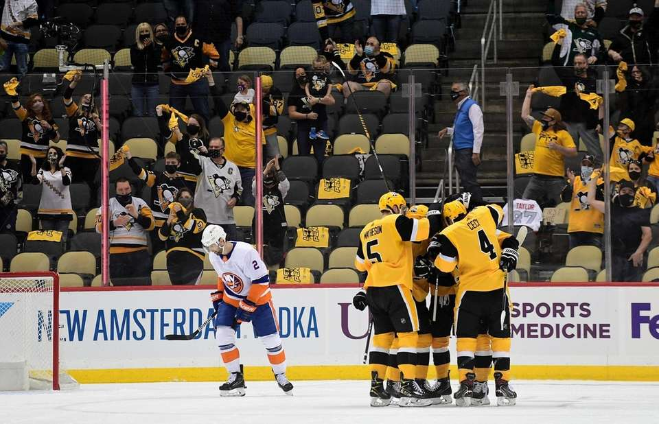The Pittsburgh Penguins celebrate a goal by Frederick