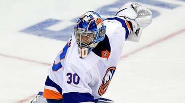 Ilya Sorokin of the Islanders eyes the net