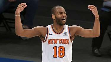 Knicks guard Alec Burks reacts after a call