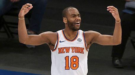 Knicks guard Alec Burks reacts after a call