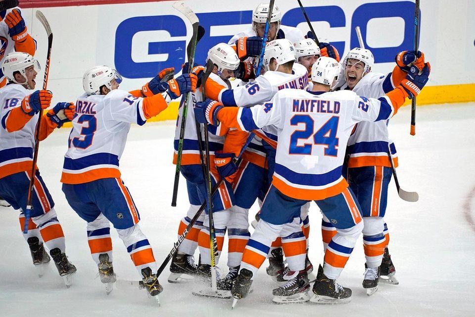 The Islanders celebrate a winning overtime goal by
