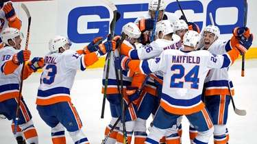 The Islanders celebrate a winning overtime goal by