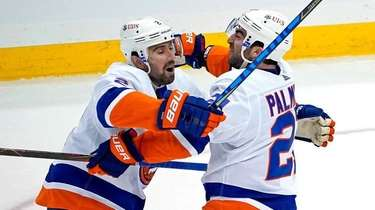 The Islanders' Kyle Palmieri, center, celebrates with Nick