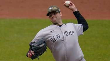 Yankees starting pitcher Jordan Montgomery throws a pitch