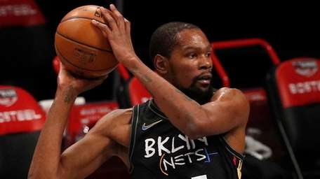 Kevin Durant of the Nets controls the ball