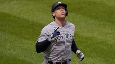 The Yankees' Aaron Judge gestures after hitting a