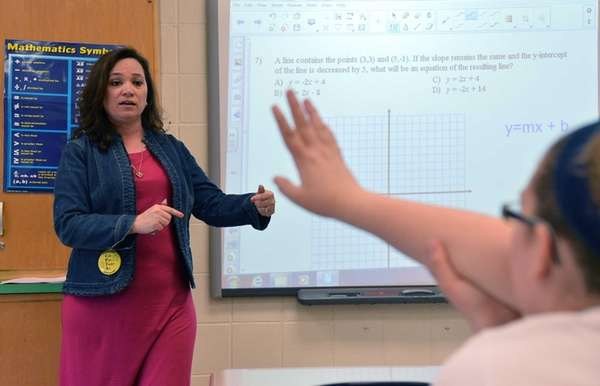 Caryl Lorandini teaches one of her eighth-grade math