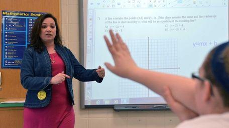 Caryl Lorandini teaches one of her eighth-grade math