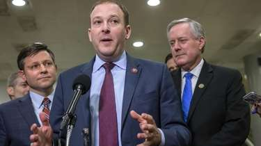 Rep. Lee Zeldin speaks to reporters during President