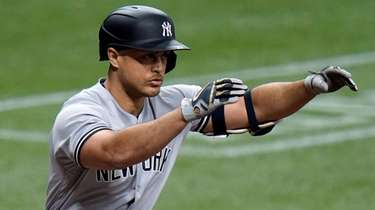 The Yankees' Giancarlo Stanton reacts as he flies