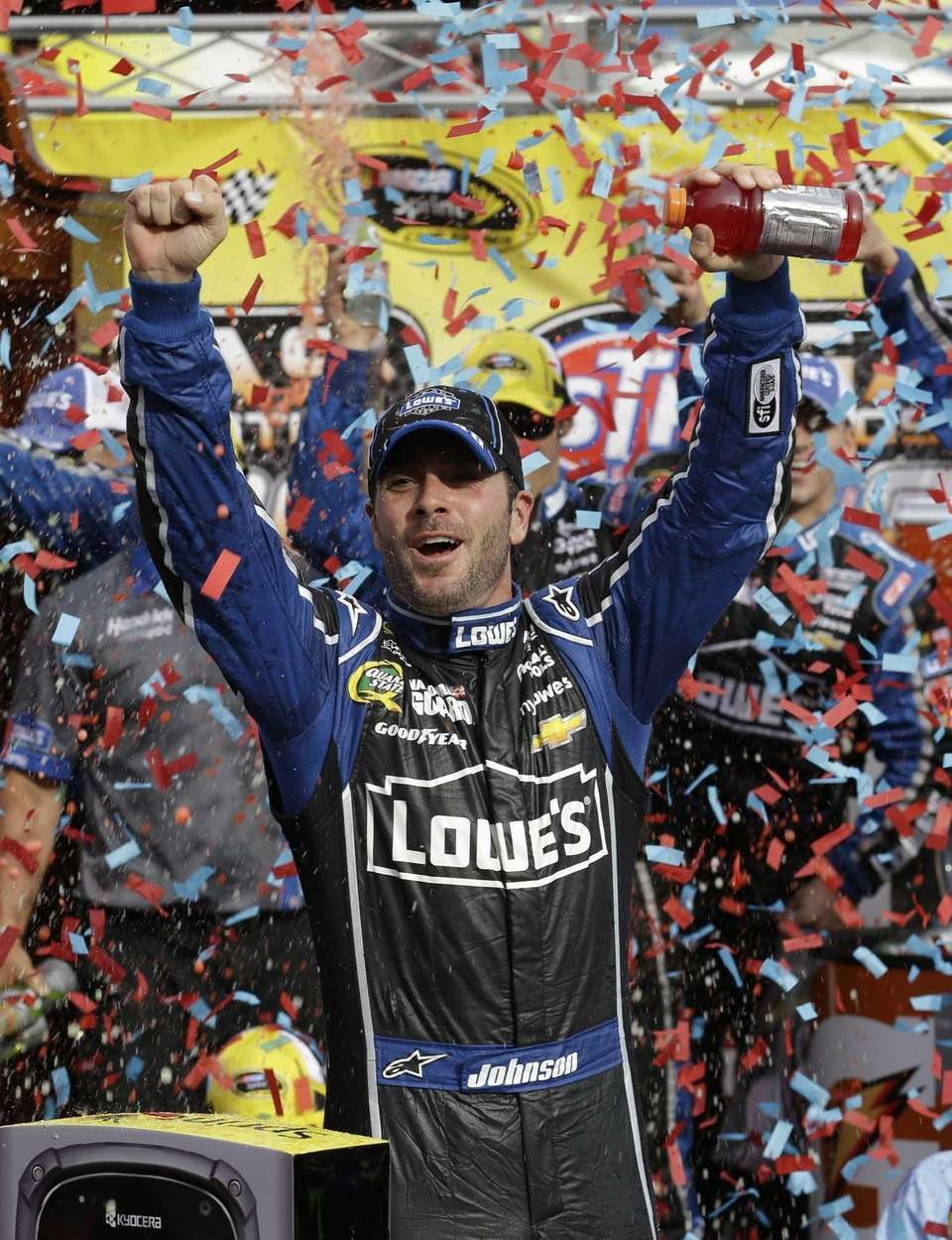 Jimmie Johnson celebrates winning the NASCAR Sprint Cup