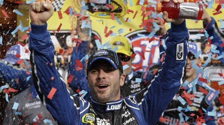 Jimmie Johnson celebrates winning the NASCAR Sprint Cup