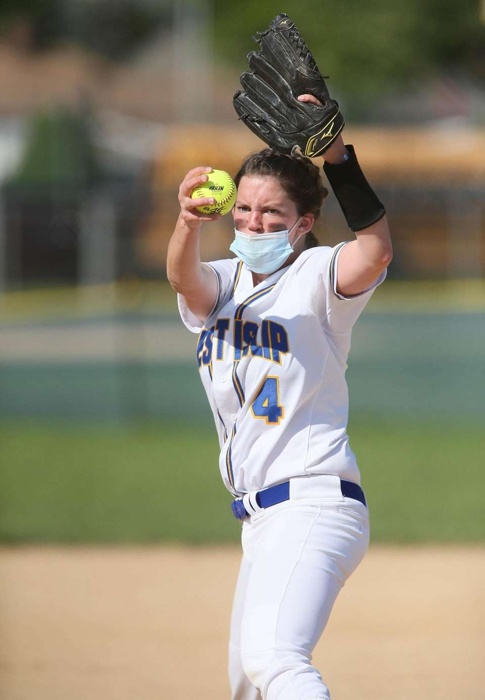 West Islip's Kayla Sauers (14) throws a pitch