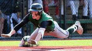Longwood's Joe McDonald slides safely into home plate,