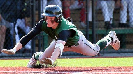 Longwood's Joe McDonald slides safely into home plate,