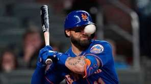 New York Mets' Kevin Pillar is hit in