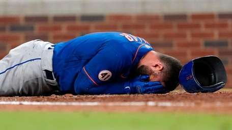 New York Mets' Kevin Pillar lies on the