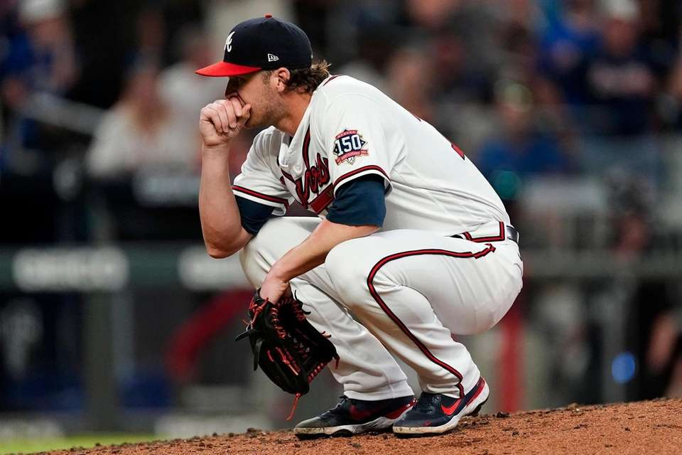 Atlanta relief pitcher Jacob Webb reacts after hitting