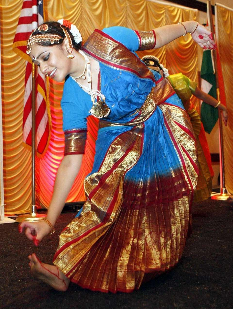 Costumed dancers perform for the thousands of visitors