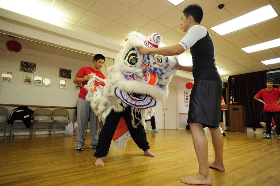 Lion master Randy Yung directs lion dance troupe