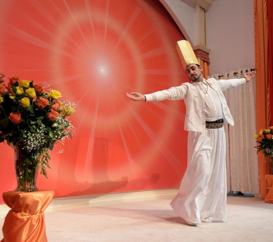 Nicholas Sattinger of Manhattan dances during the Shiv