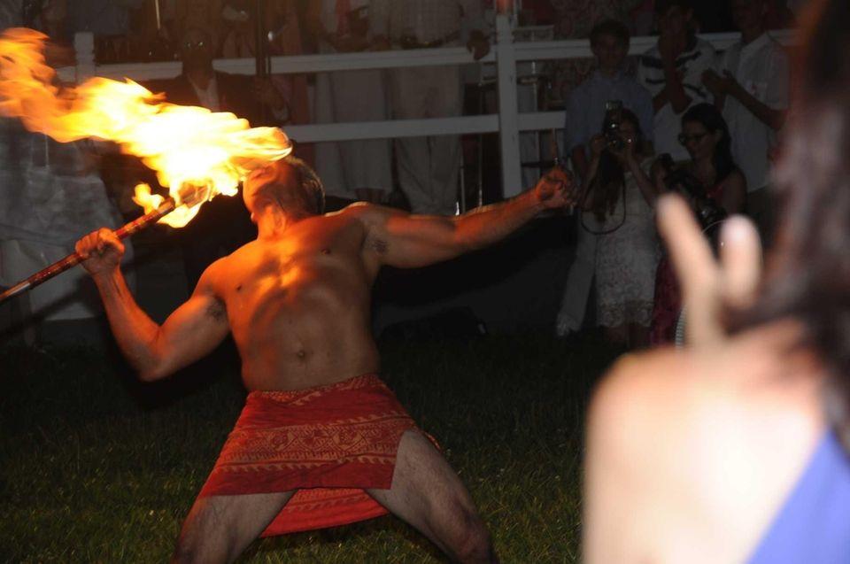 Coppin Colburn, a Hawaiian fire dancer, performs at