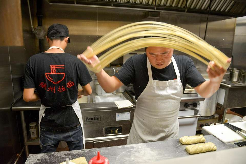 Chef Ken Chen makes hand-pulled noodles in the