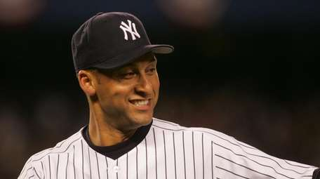 Derek Jeter smiles after making a nice play