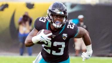 Jaguars running back Ryquell Armstead runs the ball