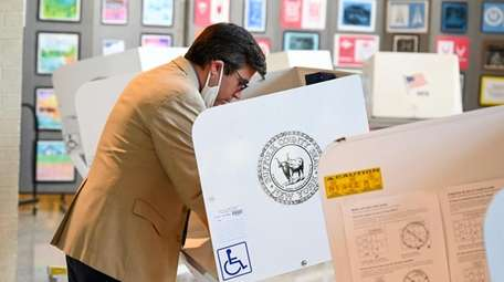 John Doyle, of Shirley, casts his vote at