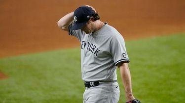 New York Yankees starting pitcher Gerrit Cole walks