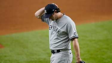 New York Yankees starting pitcher Gerrit Cole walks