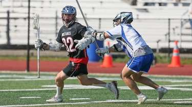 Mt Sinai's Nick Colantonio (32) looks to get
