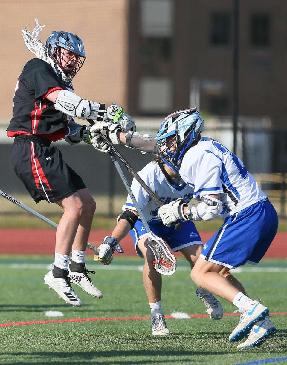 Mt Sinai's Pat Deckert shoots and scores while