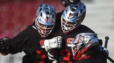 AJ Alexander #36 of Syosset, middle, gets congratulated