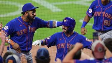 Tomas Nido #3 of the Mets reacts with