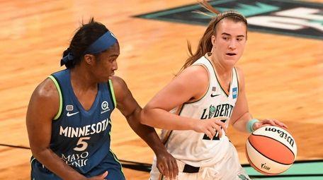 Liberty guard Sabrina Ionescu controls the ball against
