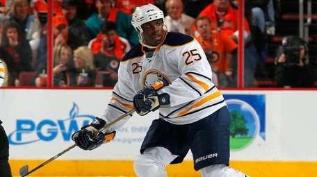 Mike Grier of the Buffalo Sabres skates against