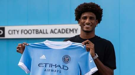 NYCFC forward Talles Magno poses after signing with
