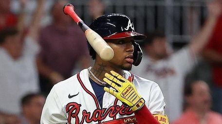 Ronald Acuna Jr. #13 of Atlanta tosses his