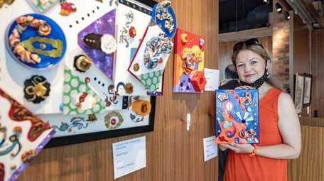 Meagan Meehan show her artwork, on display at