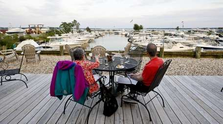 Diners sit on the outdoor deck at A
