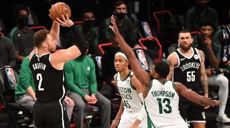 Nets forward Blake Griffin shoots for a three-point