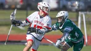 Connetquot's Tyler McCarthy (17) looks to get around