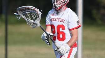Connetquot's Michael Monahan (26) looks to clear the