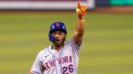 Mets' Khalil Lee gestures after hitting a double