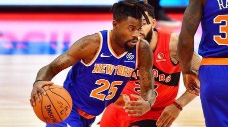 Reggie Bullock #25 of the Knicks drives to