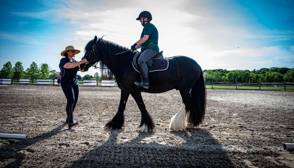 Suzanne Ament, a blind dressage competitor, gets instructions