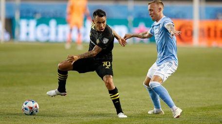 Columbus Crew midfielder Lucas Zelarrayan (10) plays the