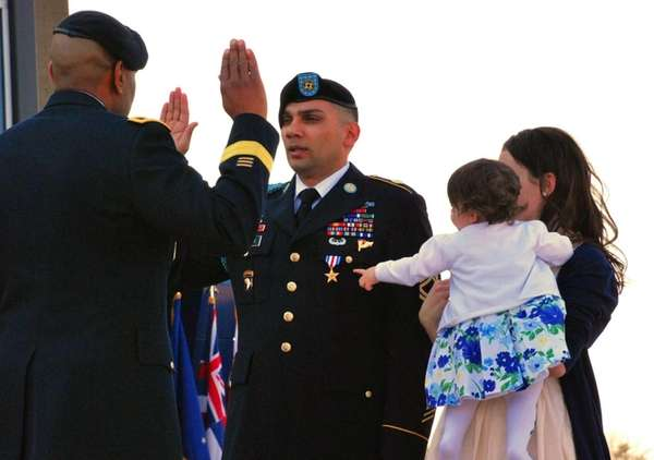 Sgt. 1st Class Matthew Loheide re-enlists in the